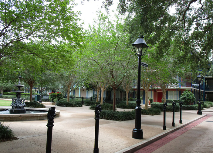 Disney's Port Orleans French Quarter streets with brick, gardens, trees, fountain