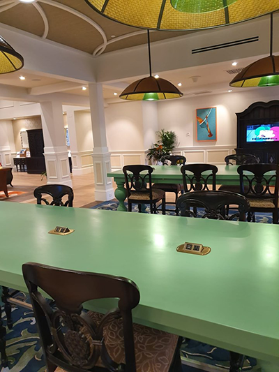 Charging station tables in lobby of Old Port Royale Caribbean Beach Resort