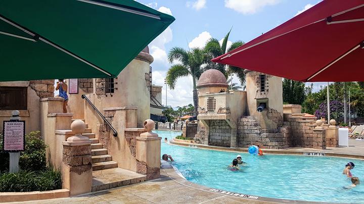 Main pool at Disney's Caribbean Beach Resort with umbrellas