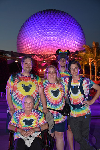 Family at Epcot with autistic mom and son