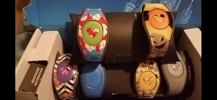 Disney World Magic Bands decorated with Etsy bought stickers made by Amy Whitaker Newbold
