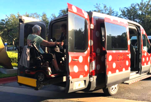 Accessible Minnie Van at Disney World being boarded