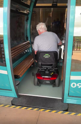 Scooter riding onto a Skyliner Gondola
