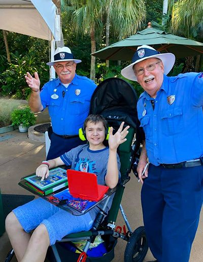 Child in a stroller marked as a wheelchair at Disney World