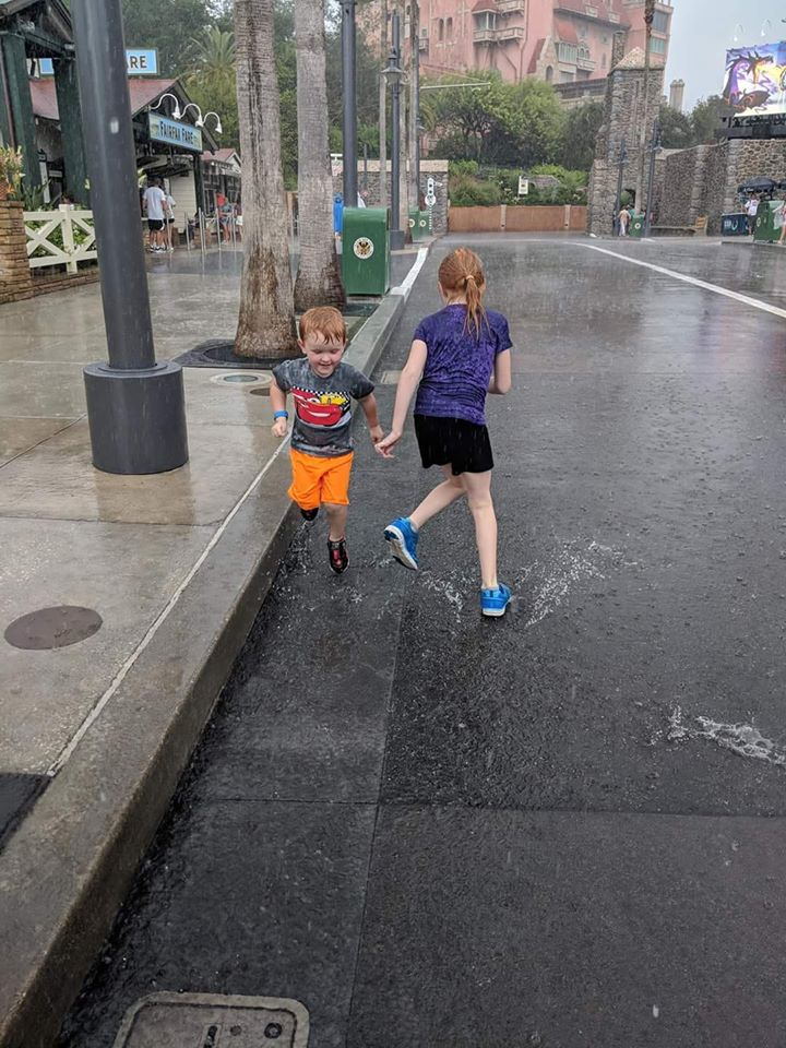 Children playing in the rain at Hollywood Studios