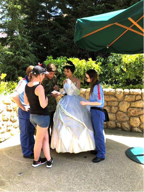 Author Katie Penn getting an autograph from a Disney World Princess