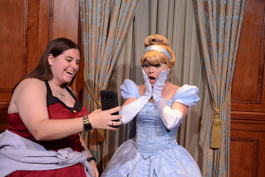 an adult visitor with Cinderella at Disney World