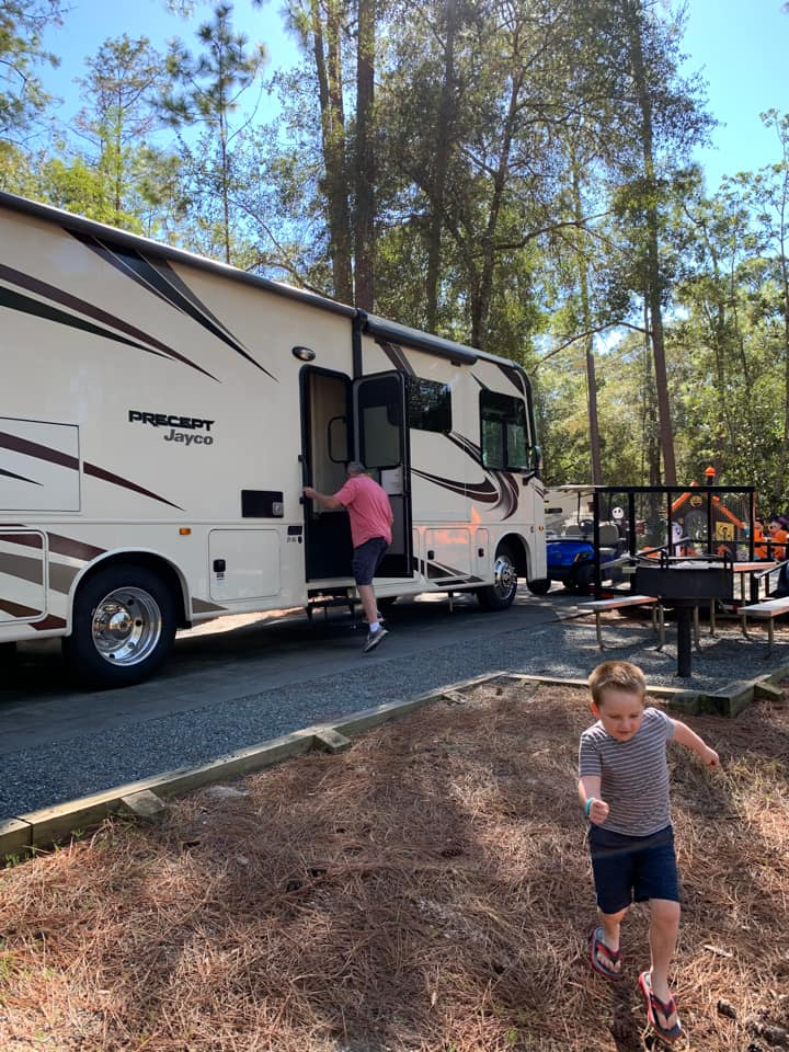 RV on a campsite at Disney's Fort Wilderness
